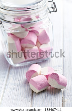 the sweet marshmallows in glass jar