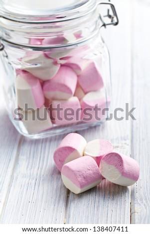 the sweet marshmallows in glass jar