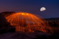 The swinging fire on the rock at Ubon Ratchathani to create a beautiful light. Stacking the Moon with Lumina4 Program.