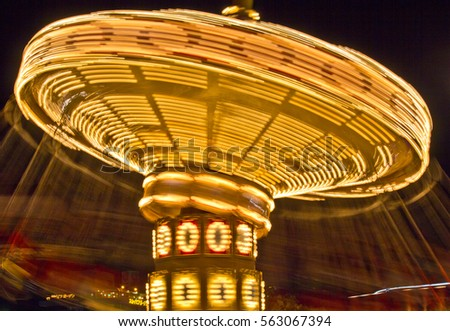 The swings on a high speed merry-go-round appear to reach light speed in the summer night sky at an amusement park in Japan in this time lapse photo.