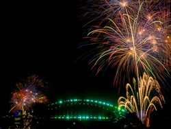 The Sydney Harbour Bridge is surrounded by fireworks welcoming in 2017
