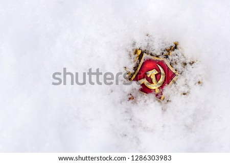 The symbol of communism is covered with snow.