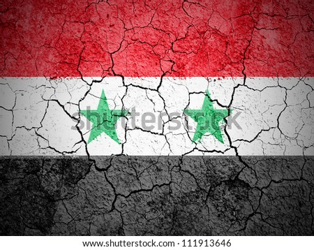 The Syria flag painted on cracked ground with vignette - stock photo