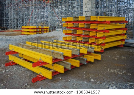 The system of metal beams and wooden beams against the background of scaffolding for the construction of the bridge #1305041557