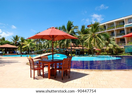 The table and chairs of outdoor restaurant near  swimming pool at luxury hotel, Bentota, Sri Lanka