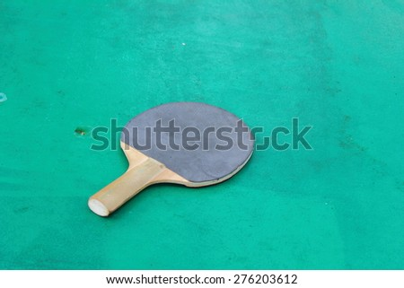 the table for table tennis racket lies
