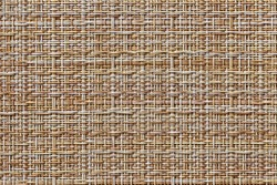 The table mat is brown, woven from thin plastic rods.