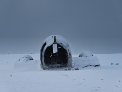 The tail of the plane wreck in Iceland in winter with fresh snow