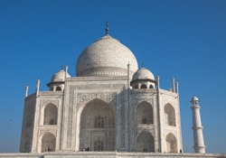 The Taj Mahal is located on the right bank of the Yamuna River in a vast Mughal garden that encompasses nearly 17 hectares, in the Agra District in Uttar Pradesh. It was built by Mughal Emperor Shah