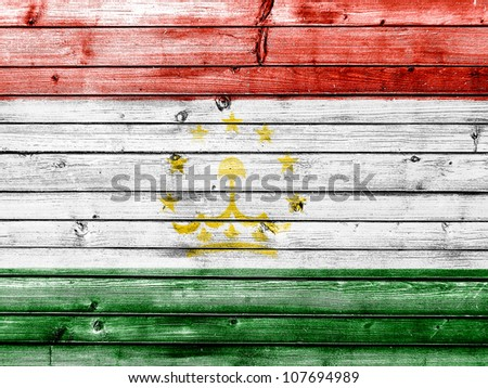 The Tajik flag painted on wooden fence