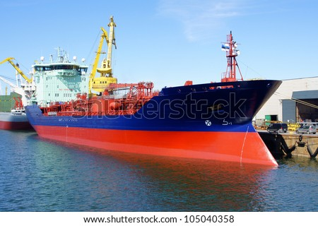 The tanker is moored in the port