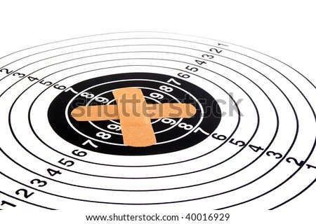 The target for accuracy training is stuck in the centre by a medical adhesive plaster.
