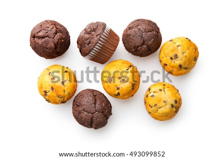 Stock Photo The tasty muffins with chocolate isolated on white background.