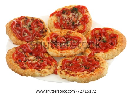 The tasty pizza is watered by ketchup