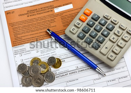 The tax form with calculator, money and pen.