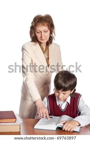 The teacher helps the pupil to understand the text