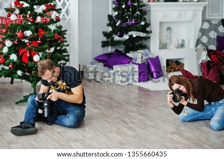 The team of two photographers shooting on studio. Professional photographer on work.