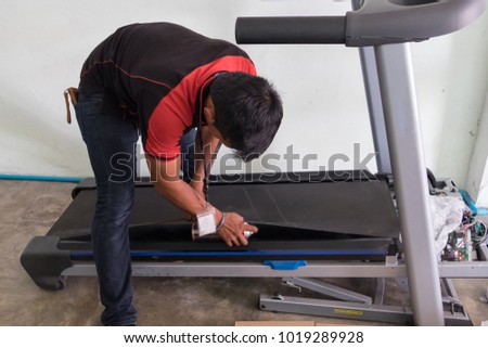 The technical repairing Treadmill and performance test speed.