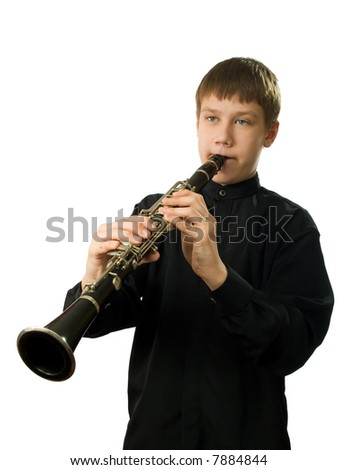 The teenager playing on a clarnet. It is isolated on a white background.