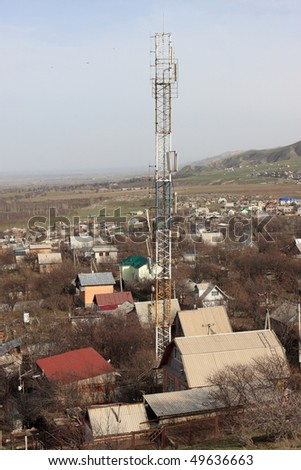 The telecom mast in a village, Kyrgyzstan