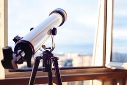 the telescope on the balcony, Telescope on the tripod, shallow depth of field