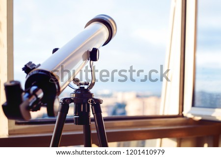 the telescope on the balcony, Telescope on the tripod, shallow depth of field