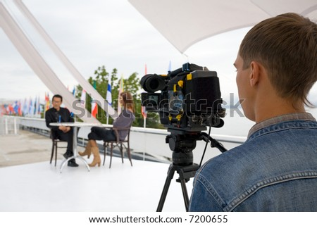 The television operator on a working platform.The reporting from the international festival.