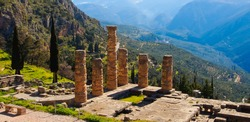 The temple of apollo and pine trees viewed from top in delphi archaeological site Greece