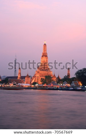 The Temple of Dawn (Wat Arun) at Twilight Time, the view across the Chaopraya river in Bangkok, Thailand