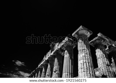 The Temple of Hera (Temple E) at Selinunte, Sicily (Italy). Columns of the Doric Greek Temple stand out against the black sky. Black and white with red filter.