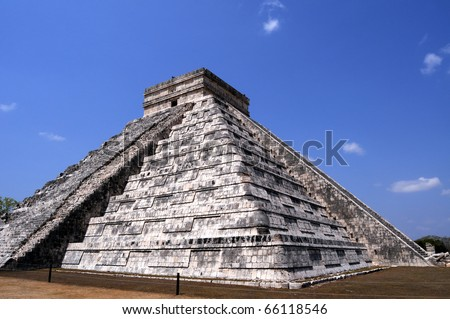 """The Temple of Kukulcan , also known as """"El Castillo"""" (the castle) is a step pyramid that dominates the center of Chichen Itza, a pre-hispanic Mayan city in Yucatan, Mexico. - stock photo"""