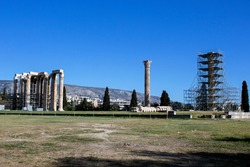 The Temple of Olympian Zeus also known as the Olympieion with ongoing maintenance works. Is a former colossal temple at the center of the Greek capital Athens. Sunny day with blue sky