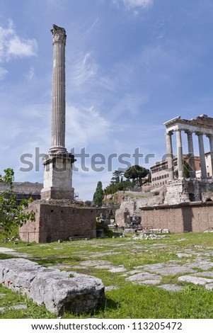 The Temple of Saturn and Column of Phocas in the Roman Forum in Rome, Italy.