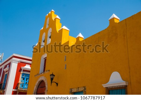 The temple with bells. Yellow church and colonial architecture in San Francisco de Campeche., Mexico #1067787917