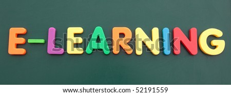 The term e-learning built out of colored bold letters on a blackboard. - stock photo