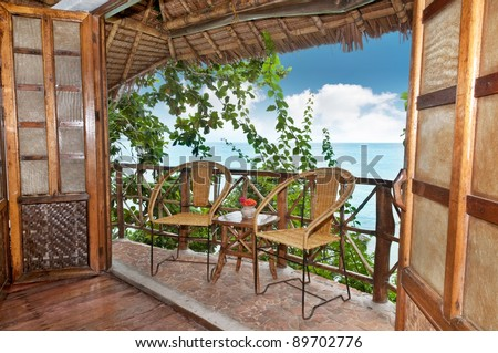 The terrace of a wooden bungalow with sea view