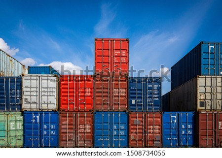 The territory of the container freight yard:a lot of metal containers for storing goods of different colors, stacked in rows on top of each other.Conception of storage of goods by importers, exporters
