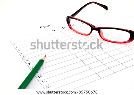 The test list and pencil and glasses  on the examination