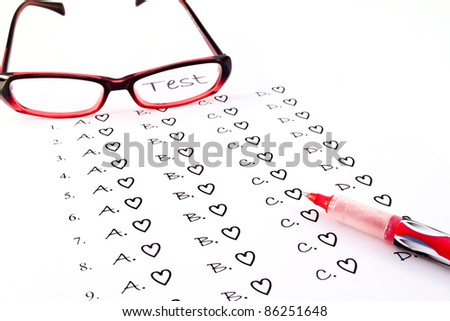 The test list and red pen and glasses  on the examination
