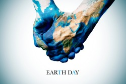 the text earth hour and two people holding hands, patterned with a world map (furnished by NASA)