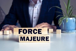 The text Force Majeure on a wooden blocks. Business concept photo