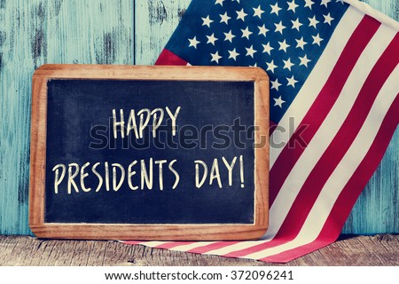 Shutterstock the text happy presidents day written in a chalkboard and a flag of the United States, on a rustic wooden background
