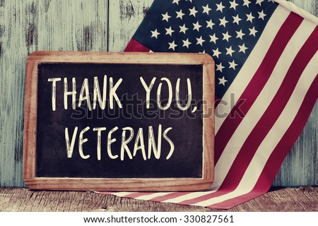 Shutterstock the text thank you veterans written in a chalkboard and a flag of the United States, on a rustic wooden background