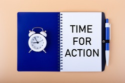 The text TIME FOR ACT is written in a notebook next to a white alarm clock and pen. Motivation concept.