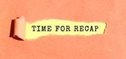 The text TIME FOR RECAP appearing on yellow paper behind torn color paper.