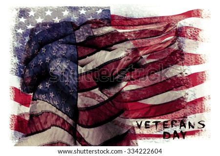 the text veterans day written in a double exposure of a flag of the United States and a closeup of the clasped hands of a man praying