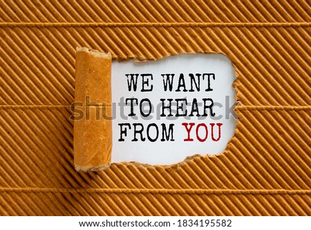 Photo of  The text 'we want to hear from you' appearing behind torn brown paper. Beautiful background. Business concept.