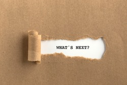 The text WHAT'S NEXT? behind torn brown paper
