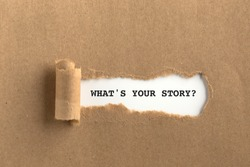 The text WHAT'S YOUR STORY? behind torn brown paper