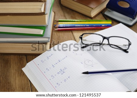 The textbook with pen on it on the wooden desk